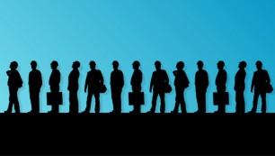 Men,Engineers,Miners,And,Construction,Workers,In,Helmets,Work,Line